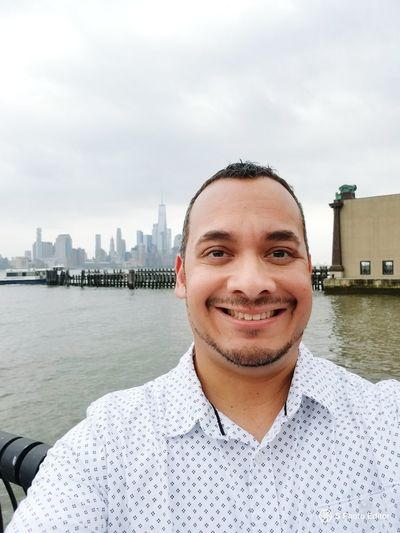 Urban Skyline Water Portrait Smiling Looking At Camera Cheerful