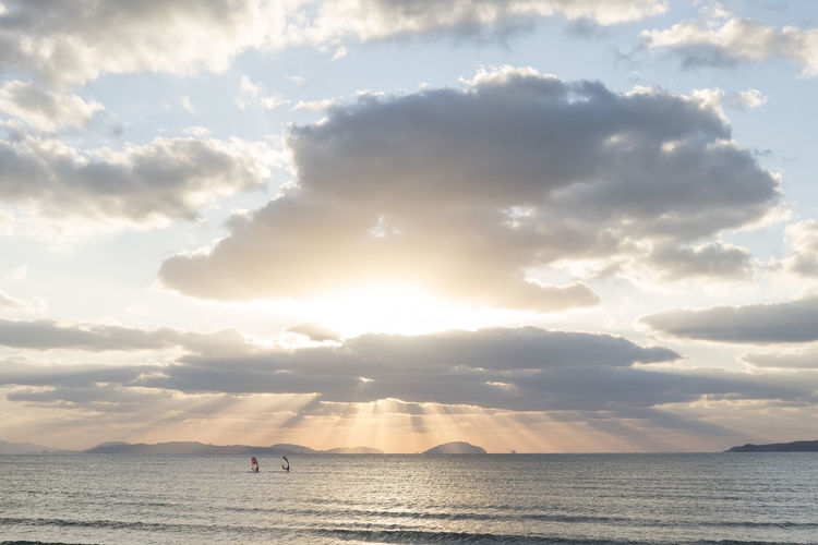 Japan Sun Rays Through The Clouds Sunlight Sunset_collection Action Sports Beach Beauty In Nature Cloud - Sky Clouds Horizon Over Water Ocean Religious  Sailing Scenics Sea Sun Beams Sun Rays Sunbeams Through Clouds Sunset Tranquil Scene Tranquility Water Windsurfer Windsurfers Windsurfing
