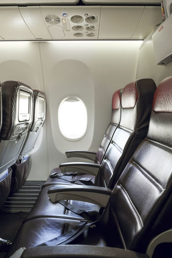 Inflight economy class cabin seats of an airplane. Boeing 737-800 In A Row Vertical Composition Aircraft Airplane Airplane Seat Cabin Day Empty Inflight Interior Journey No People Seat Transportation Travel Window