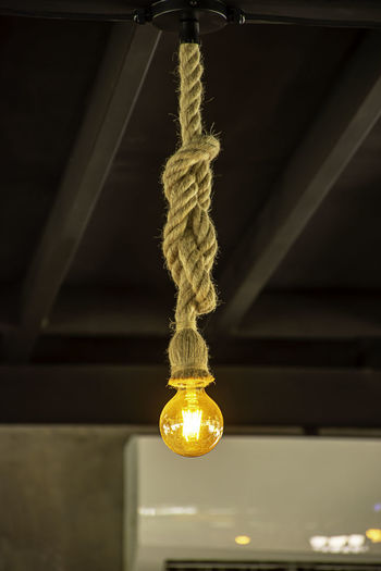 Yellow light bulb The sphere hanging with a rope. Ancient Art ASIA Background Beautiful Black Bowl Bright Brown Bulb Ceiling Chandelier City Classic Closeup Color Colorful Concept Decor Decoration Decorative Design Electric Equipment Famous Glass Gold Golden Hanging Illuminated Interior Lamp Lantern Lightning Modern Night Nobody Old Red Retro Rope Sphere Star Stick String Symbol Thai Vintage Wooden Yellow