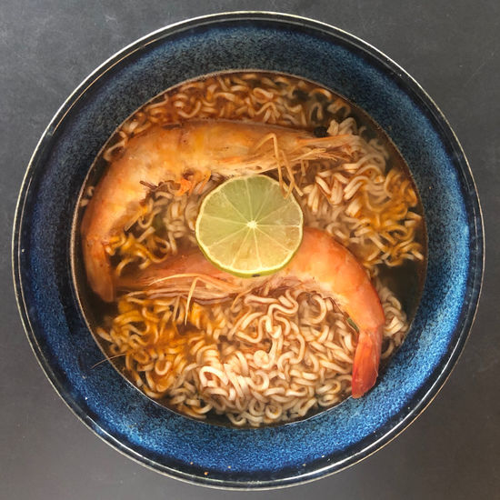 Directly above shot of noodles in bowl on table