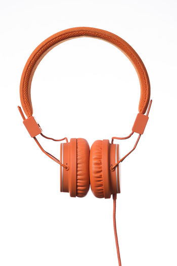 Orange Headphones on white Background Cable Close-up Computer Cable Connection Headphones Internet Network Connection Plug No People Product Product Photography Single Object Sound Studio Shot Technology White Background