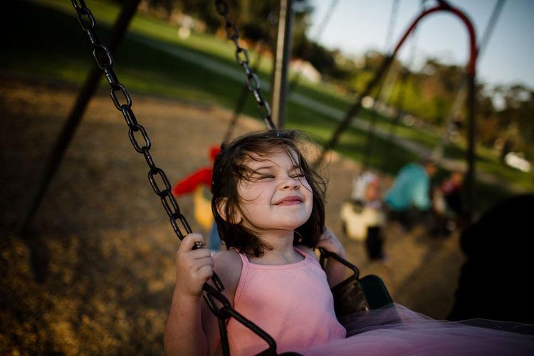Portrait of a girl on swing