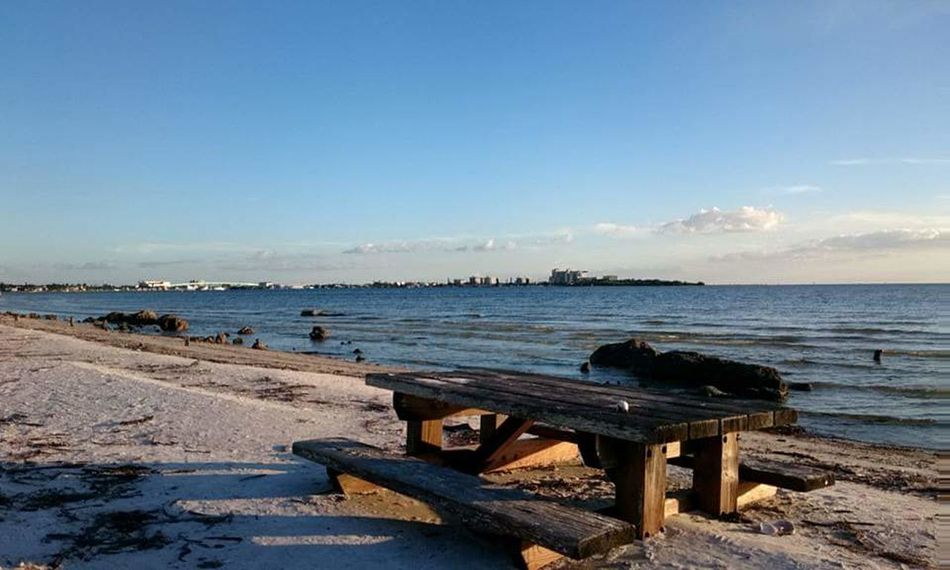 Fort Myers Beach, Florida 🌴 Sea Water Tranquil Scene Tranquility Blue Beach Bench Horizon Over Water Sky Travel Destinations Beauty In Nature Vacations Tourism Nature Shore Seascape Non-urban Scene Sunset Outdoors Evening Florida Fort Myers Fort Myers Beach Scenics Day