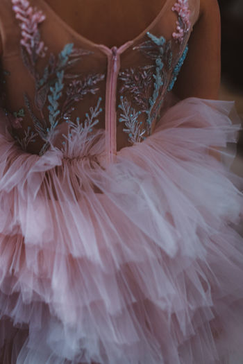 Part of baby dress with drapery and pink organza. back view