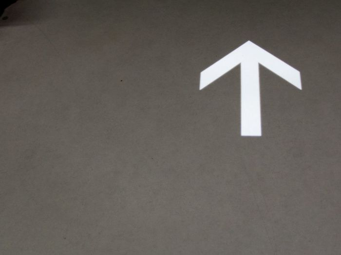 Asphalt Arrow Arrow Symbol Day Direction Guidance No People Outdoors Straight Forward Street Sign Way Ahead White Color