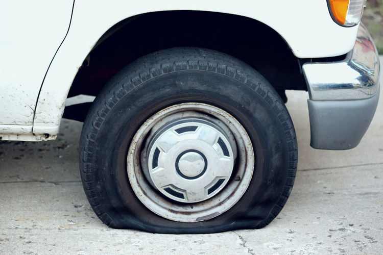 Automobile Flat Tire Tires Auto Black Color Close-up Flat Hazard Motor Vehicle No People Outdoors Parking Real Life Road Rubber Stationary Street Tire Transportation Travel Wheel
