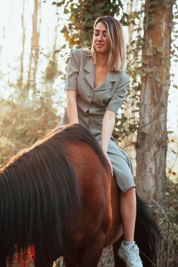 Portrait of woman riding horse
