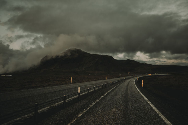 Iceland Beauty In Nature Cloud - Sky Direction Environment Long Mountain Nature No People Outdoors Overcast Power In Nature Road Scenics - Nature Sign Sky Storm Storm Cloud The Way Forward Tranquil Scene Tranquility Transportation