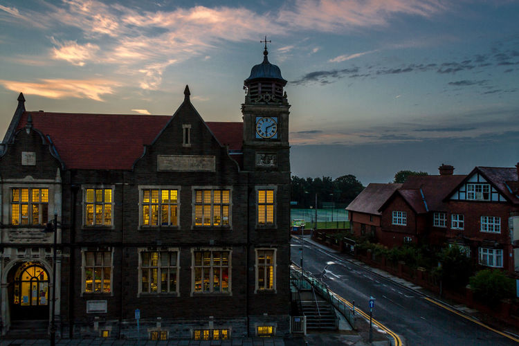 Architectural Feature Architecture Blue Sky Building Building Exterior Built Structure Clock Tower Cloud - Sky Exterior Historic History Illuminated Library Light And Shadow Outdoors Sky Sunrise Sunrise_Collection Town Windows