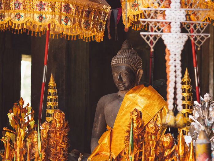 Cambodia Siem Reap Angkor Architecture Art And Craft Belief Building Built Structure Creativity Focus On Foreground Gold Colored Human Representation Idol Male Likeness No People Place Of Worship Religion Representation Sculpture Spirituality Statue