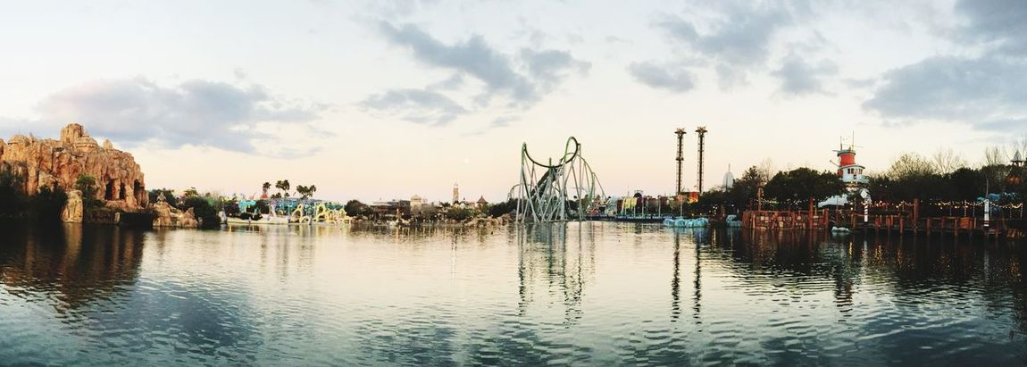 EyeEm Selects Panoramic at Universal's Islands of Adventure. Sky Cloud - Sky Water Reflection Sculpture Statue Built Structure Travel Destinations Architecture Outdoors Day Large Group Of People Building Exterior City People