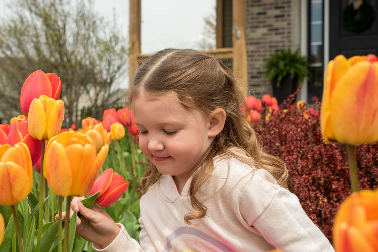Close-up portrait of girl with tulips