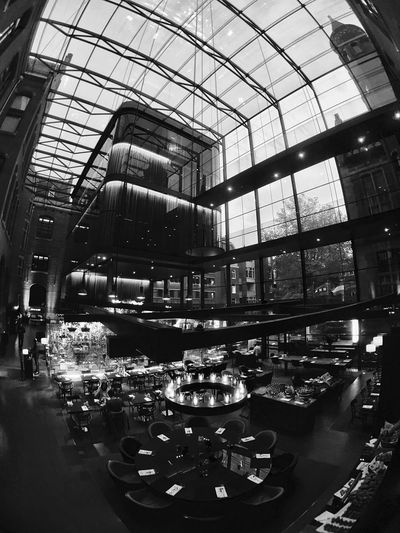 Restaurant Indoors  Cafe Built Structure Architecture Day Atrium Moment Lens Superfish Old And New Architecture Patterns & Textures Black And White Black & White Illuminated Light And Shadow IPhoneography Netherlands Architectural Design Interior Design Lighting Effects Conservatorium Van Amsterdam Architecture Indoors  Decorative Lights Decorative Lighting