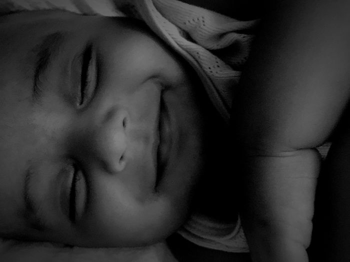 Real People One Person Indoors  Eyes Closed  Human Face Close-up Home Interior Lifestyles Bed Young Adult Relaxation Young Women Childhood Day People Kidsphotography Kid Smiling Smiling In His Sleep Baby