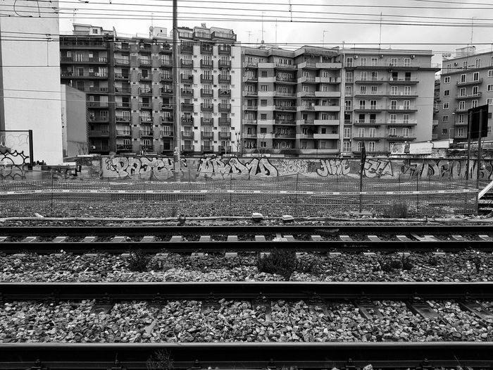 Building Exterior Built Structure Blackandwhite Backgrounds Black & White Train Train Station Graffiti Graffiti Art Graffiti Wall Building Blackandwhite Photography Brick Wall Urban Urban Skyline Urbanphotography Bari Italy Apúlia Puglia Trains Sky Black White Grey EyeEmNewHere