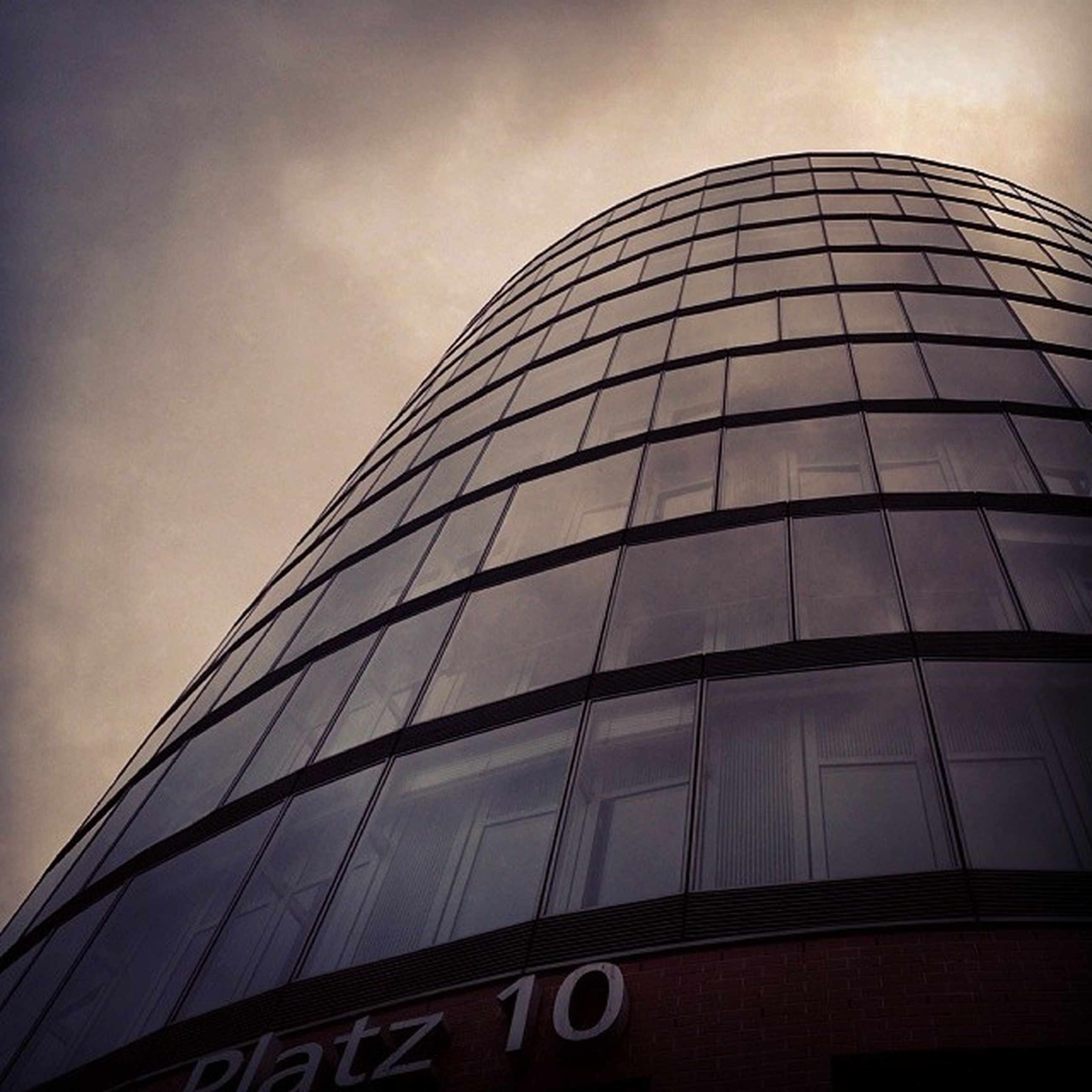 architecture, building exterior, low angle view, built structure, modern, office building, skyscraper, city, tall - high, glass - material, building, sky, tower, reflection, window, no people, day, outdoors, tall, city life