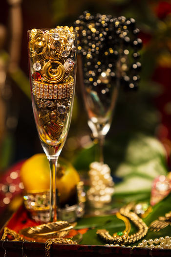 Celebrational Abundance Abundance Wealth Celebration Decoration Jewelry Pearls Glass Food And Drink Alcohol Wine Refreshment Wineglass Drink Close-up Food Focus On Foreground No People Selective Focus Still Life Glass - Material Transparent Table Champagne Champagne Flute Indoors  Luxury Red Wine