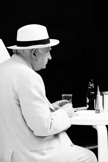 Cultivated Drinking Leisure Activity Lifestyles Old Man Pause Portrait Of A Man  Portrait Photography Silhouette Streetphotography Suit Taking A Break Taking A Break In The Shadow The Portraitist - 2016 EyeEm Awards The Street Photographer - 2016 EyeEm Awards White Hat Monochrome Photography