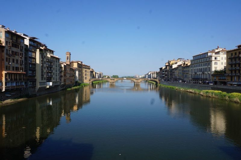 Architecture Built Structure Building Exterior Water Reflection Waterfront Outdoors Day River City Clear Sky Travel Destinations No People Sky Nature Bridge Florence Italy Lost In The Landscape