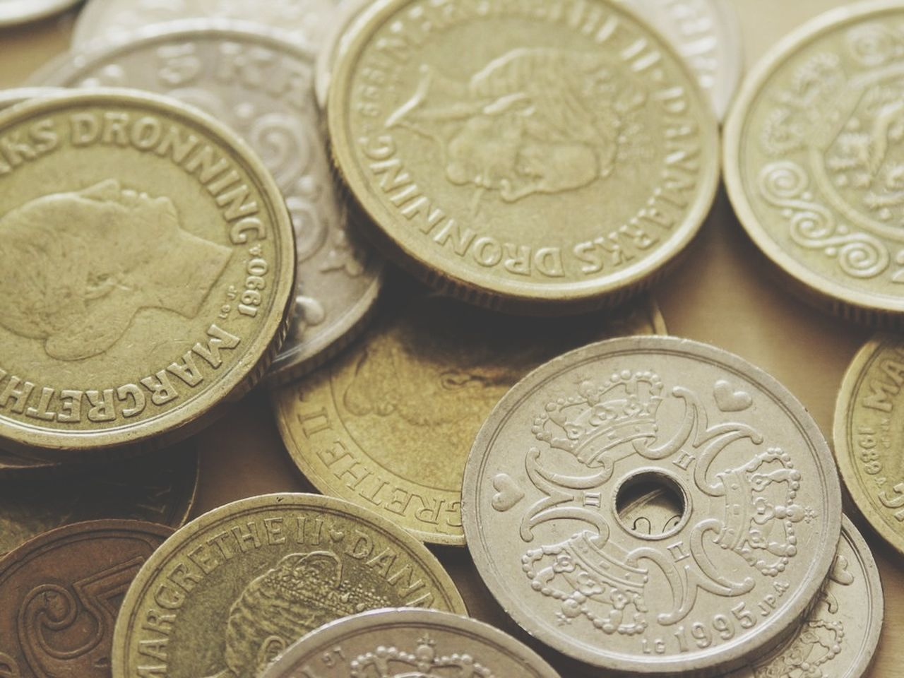 FULL FRAME SHOT OF COINS ON METAL