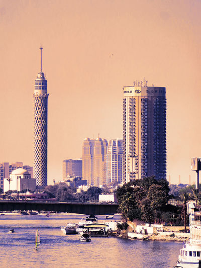 City Architecture Building Exterior Travel Destinations Urban Skyline Tower Built Structure City Life Skyscraper Modern Water Development Nautical Vessel Cityscape No People Business Finance And Industry Bridge - Man Made Structure Outdoors Yacht Day The Nile River