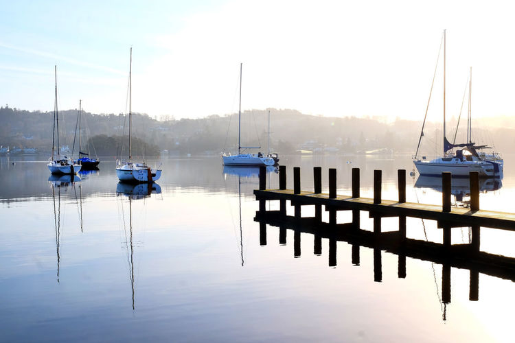 Lake District National Park Peaceful View Beauty In Nature Day In A Row Jetty View Lake Lake View Lake Windermere Mast Mode Of Transport Moored Nature Nautical Vessel No People Outdoors Peaceful Moment Reflection Scenics Sky Tranquil Scene Tranquility Transportation Water Wooden Post