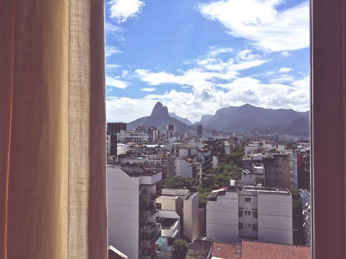 Rio de Janeiro view Rio De Janeiro Eyeem Fotos Collection⛵ Rio De Janeiro Rio De Janeiro Architecture Built Structure Cloud - Sky Building Exterior City Sky Building Nature Mountain Day Residential District Cityscape Mountain Range Window Outdoors High Angle View Sunlight TOWNSCAPE