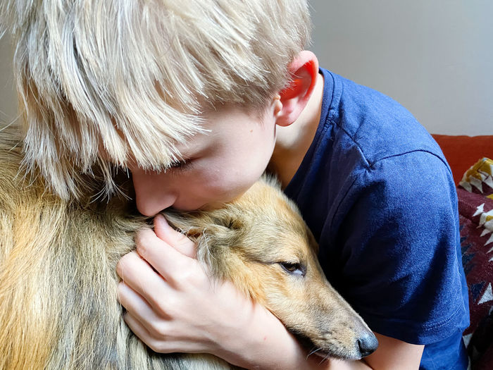 High angle view of boy with dog