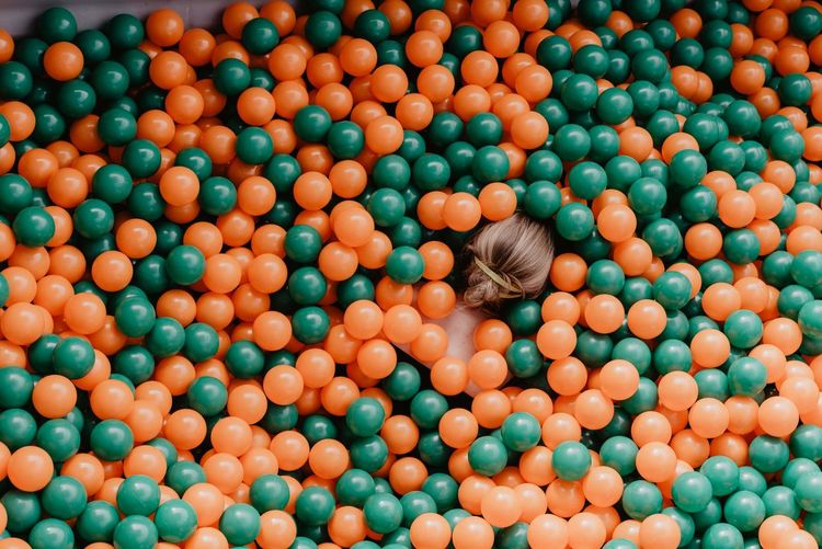 High angle view of various ball in container