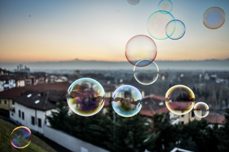 Close-up of bubbles against sky at sunset