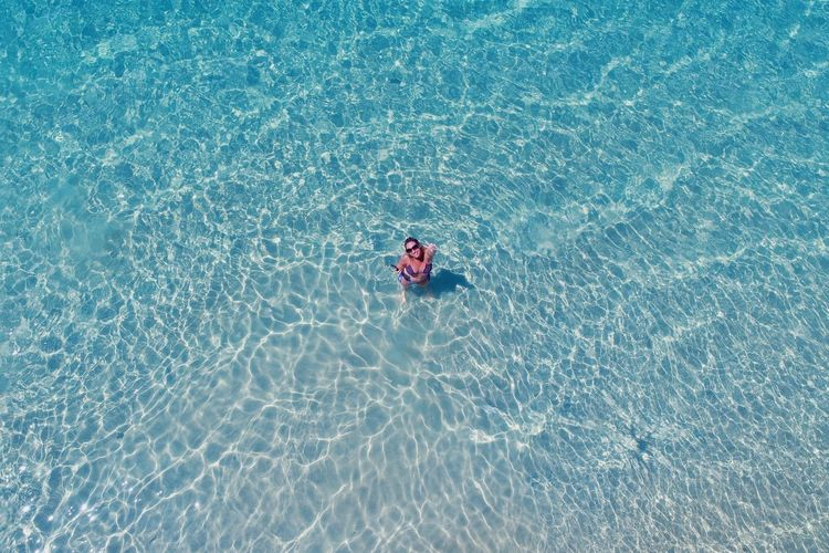 Aerial view of woman in sea