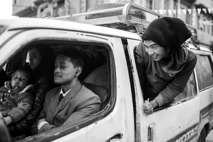 a beautiful thing about Nepal was the way of transportation. I just loved how the guys looked out of the car. Traveling Monochrome Shootermag EyeEm Best Shots Open Edit The Photojournalist - 2015 Eyeem Awar Nepal Kathmandu
