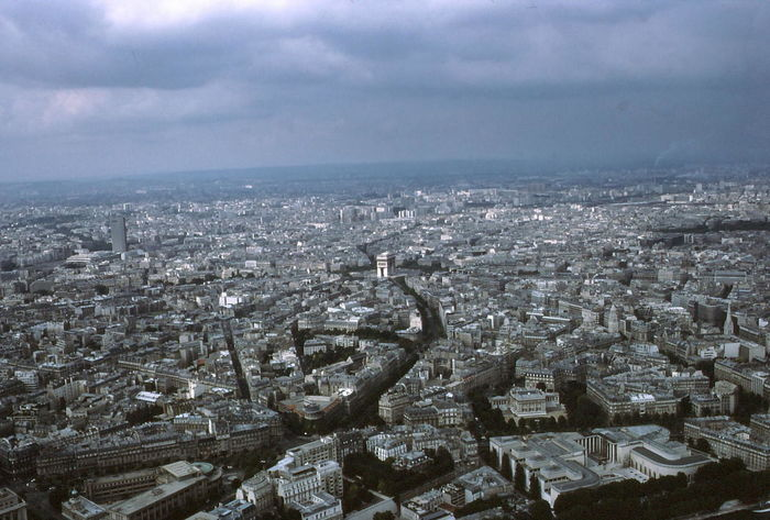 Paris Viewed from Eiffel Tower, Arch de Triomphe in Middle of Picture Aerial View Architecture Buildings Built Structures City City Cityscape Cloudy Sky Composition Distant View Eiffel Tower Elevated View France Grey Sky High Angle View Horizon Over Land Human Settlement Landscape Moody No People Outdoors Paris River Tourist Destination Travel Destinations
