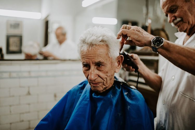 I just walked in and asked for a photo. They were amused I guess. The Portraitist-2018 EyeEm Awards Men Males  Adult Focus On Foreground Real People Indoors  Hairdresser People Lifestyles Barber Barber Shop The Portraitist - 2018 EyeEm Awards The Week On EyeEm Editor's Picks