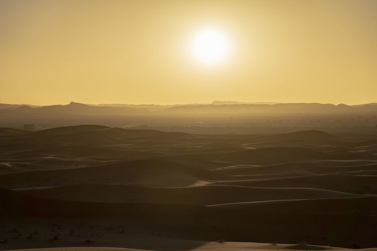Tranquil Scene Tranquility Sky Sun Landscape Sunlight Sunset Land No People Sunbeam Lens Flare Outdoors Bright Dramatic Landscape Arid Climate Desert Desert Sunset Desert Beauty Desert Landscape Golden Hour Sand Sand Dune Sahara North Africa Middle East