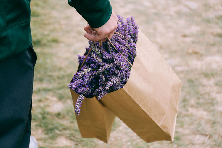 Man Carrying Bag Of Flowers
