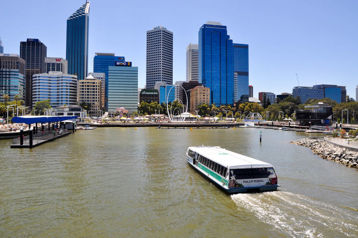 The Transperth ferry boating into Elizabeth Quay in Perth, Western Australia. Architecture Building Exterior City Cityscape Elizabeth Quay Ferry Foreshore Inlet Lifestyle Modern Nautical Vessel Outdoors Perth River Sailing Sky Skyscraper Spanda Transperth Transportation Travel Destinations Urban Urban Skyline Water Western Australia