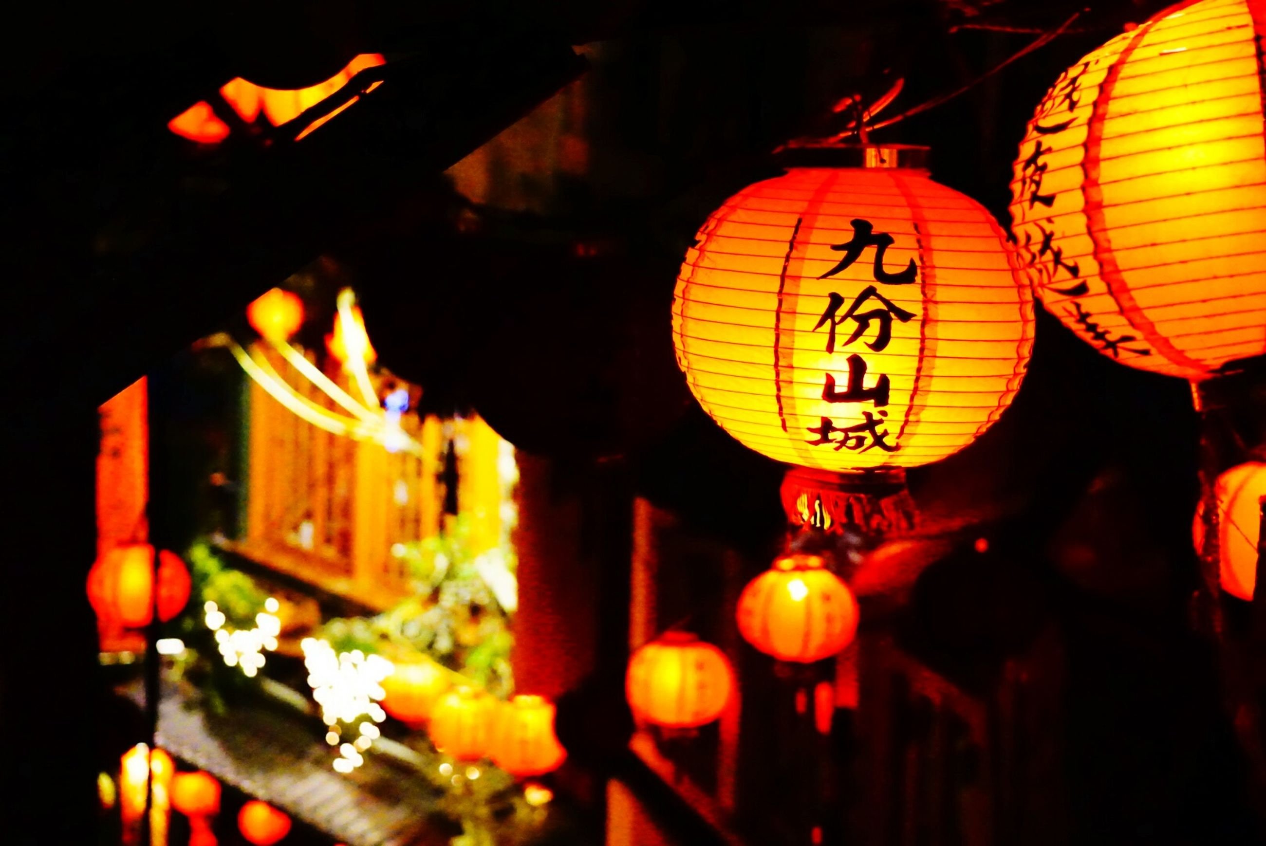 illuminated, night, lighting equipment, lantern, hanging, decoration, low angle view, chinese lantern, electricity, celebration, electric light, cultures, indoors, tradition, light - natural phenomenon, glowing, orange color, traditional festival, electric lamp, no people