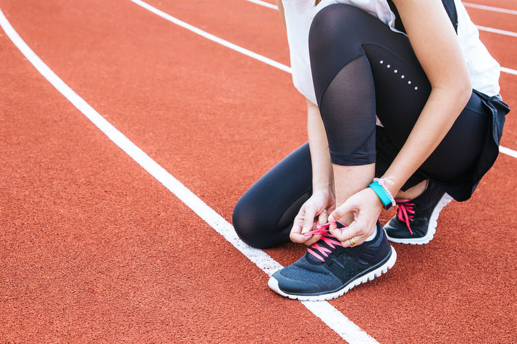 Woman was iied the shoelace befor run Athlete Body Part Competition Exercising Healthy Lifestyle Human Body Part Human Leg Lifestyles Low Section One Person Outdoors Preparation  Real People Running Track Shoe Sport Sports Clothing Sports Race Sports Track Track And Field Track And Field Athlete