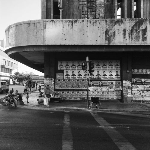 Streetphotography Streetphoto_bw Streetcorner City Cityscape City Life Blackandwhite Blackandwhite Photography Woman Waiting On My Way CityWalk Traveling Travel Photography Cebu City Itsmorefuninthephilippines Weelchair Old Buildings