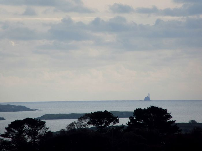 13km out in the Atlantic ocean is the Fastnet lighthouse Sea Tree Water Horizon Over Water Scenics Tranquil Scene Sky Growth Tranquility Beauty In Nature Nature Tourism Cloud - Sky Coastline Outdoors Cloud Day Lighthouse Atlantic Ocean Mizen Peninsula Fastnet Wildatlanticway Ireland