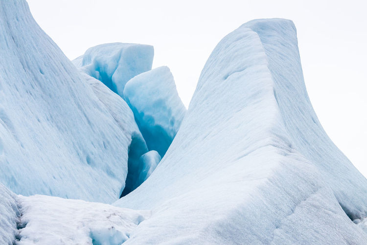 Low angle view of glacier against clear sky
