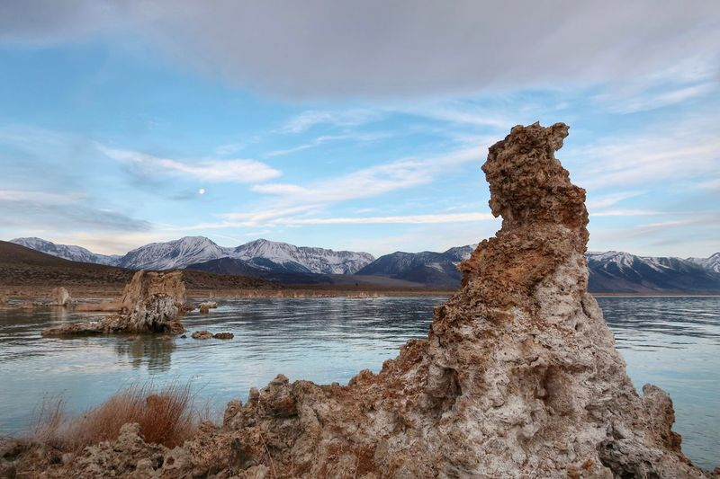 Landscape of tufa formations, Mono Lake and snow covered mountains Sierra Nevada Mountains Tufa Mono Lake Water Sky Cloud - Sky Scenics - Nature Beauty In Nature Mountain Nature Lake Tranquil Scene Mountain Range Non-urban Scene Day Rock No People Solid Beach Rock - Object Tranquility