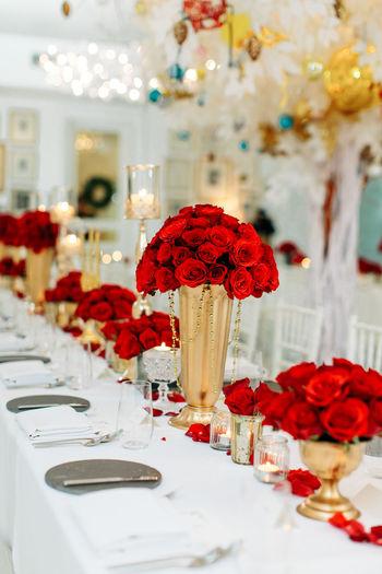 Red flower vase on table