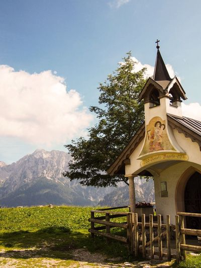 Chapel on the ascent. Alps Mountains