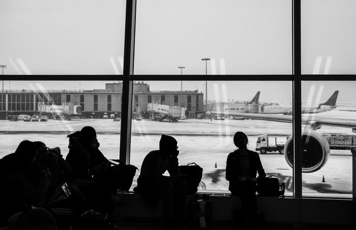 Airport Window Travel Waiting Airport Departure Area Silhouette Street Photography Snow Day Winter New York City Photos Black And White Black And White Photography The City Light Traveling New York City Shadows & Lights Shadow And Light New York, New York Airport Waiting Black & White Snow Snowing Black And White Friday The Traveler - 2018 EyeEm Awards