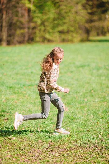 Full length of girl on grass