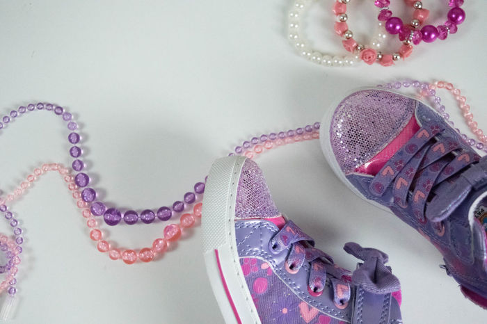 Beads Copy Space Feminine  Braclet Celebration Close-up Copyspace Day Femininity Girly Girlygirl Girlythings High Angle View Indoors  Jewelry Little Girl No People Pink Color Purple Shoes Sneakers Style Styled Table