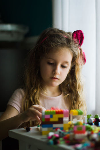 Blond Hair Brown Hair Casual Clothing Childhood Close-up Cute Focus On Foreground Girls Headshot Home Innocence LEGO Leisure Activity Lifestyles Long Hair Portrait Selective Focus
